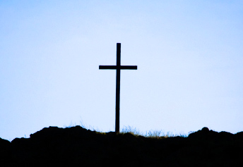 cross on hill skyline